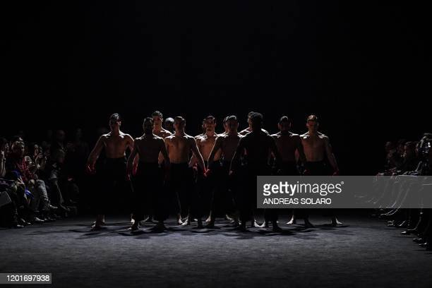 Dancers perform prior to the presentation of Chinese designer Han Wen's Fall Winter 2020 fashion collection as part of the China We are With You...