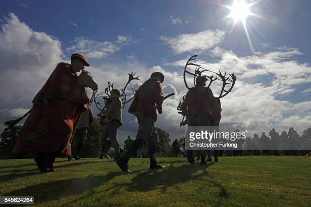 Dancers perform the Abbots Bromley Horn Dance on September 11 2017 in Abbots Bromley United Kingdom The dance comprising of six Deermen a Fool Hobby...