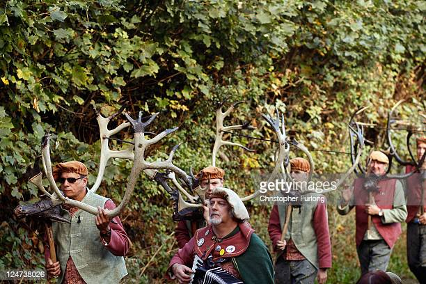 Dancers perform the Abbots Bromley Horn Dance on September 12 2011 in Abbots Bromley United Kingdom The dance comprising of six Deermen a Fool Hobby...