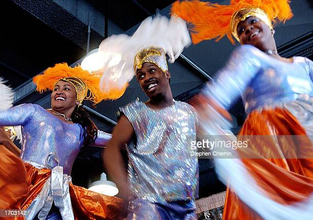 Dancers perform to Calypso music during a Kwanzaa festival at the Museum of Natural History December 28 2002 in New York City Kwanzaa started in 1966...