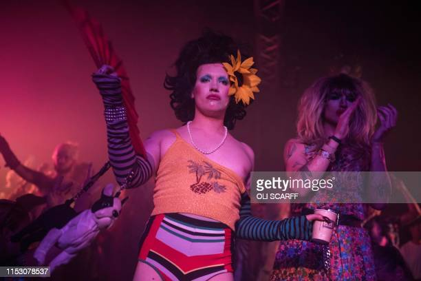 Dancers perform to entertain festivalgoers in the NYC Downlow club in the Block9 area of the Glastonbury Festival of Music and Performing Arts on...
