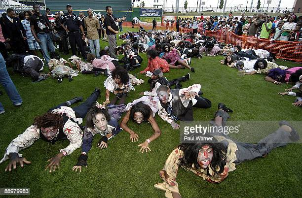 Dancers perform to the Michael Jackson song Thriller at a memorial for the late singer at U.S. Steel Yard ballpark on July 10, 2009 in Gary, Indiana.