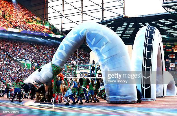 Dancers perform with a Loch Ness Monster during the Opening Ceremony for the Glasgow 2014 Commonwealth Games at Celtic Park on July 23 2014 in...