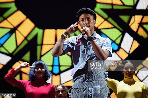 Dancers perform with Pharrell Williams on stage during the MTV EMA's 2015 at the Mediolanum Forum on October 25 2015 in Milan Italy