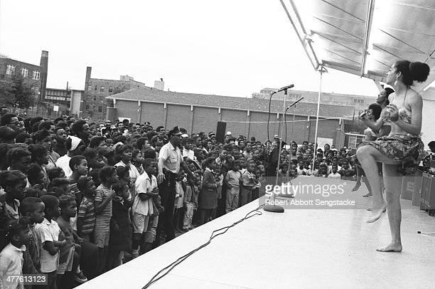 Dancers perform with Phil Cohran and the Artistic Heritage Ensemble at Cabrini Green Chicago Illinois 1968 or 1969