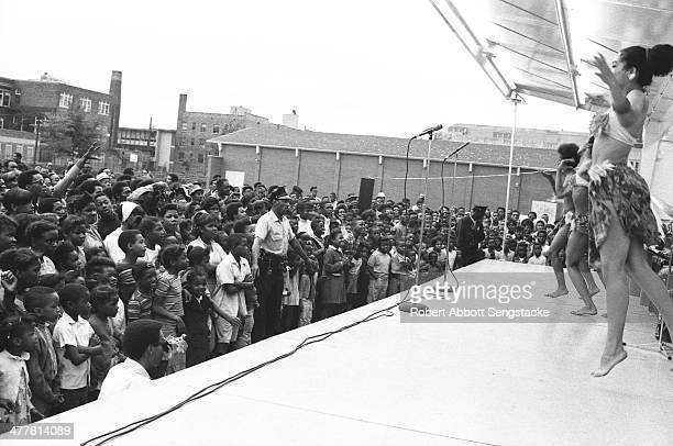 Dancers perform with Phil Cohran and the Artistic Heritage Ensemble at Cabrini Green, Chicago, Illinois, 1968 or 1969.