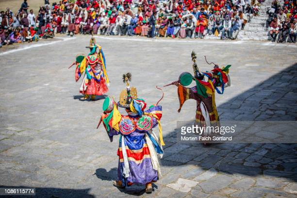 dancers performing traditional dance in paro, bhutan - paro district stock pictures, royalty-free photos & images