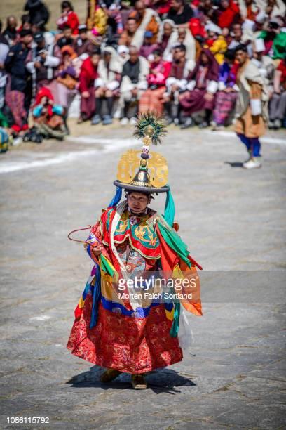Dancers performing traditional dance in Paro, Bhutan