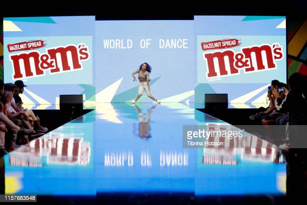 A dancers performs onstage during World of Dance at BET Her Presents Fashion Beauty during the BET Experience at Los Angeles Convention Center on...