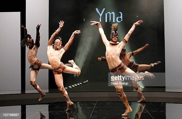 Dancers performs wearing costumes designed by designer Michael Michalsky at the teaser presentation of Yma zu schoen um war zu sein at the Michalsky...
