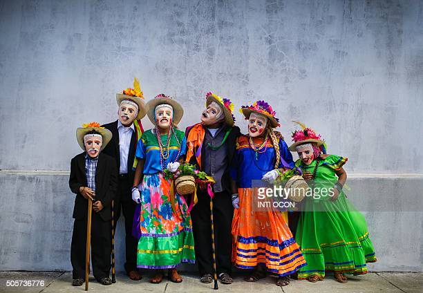 TOPSHOT Dancers pose after performing 'El Macho Raton' 'El Toro Huaco' and 'El Gueguense' traditional dances during San Sebastian festivity in...