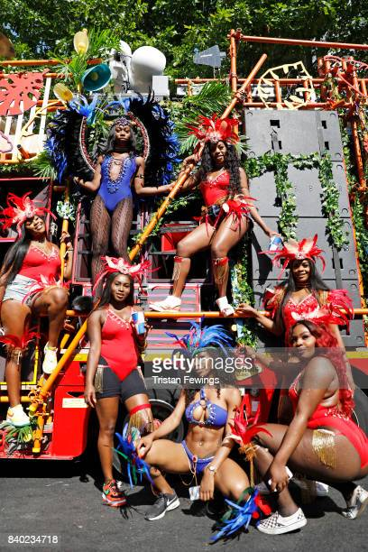 Dancers pose in front of the Red Bull Music Academy x Mangrove float at Notting Hill Carnival on August 28 2017 in London England