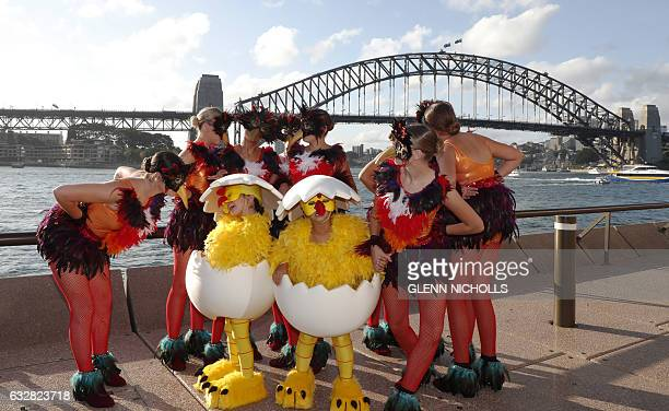 Dancers pose in front of the Sydney Harbour bridge during the Lunar New Year celebrations in Sydney on January 27 2017 Much of the region will...