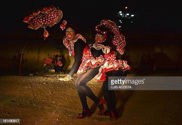 Dancers poses after taking part in the third day of carnival in Barranquilla Colombia on February 11 2013 Barranquilla's Carnival a tradition created...