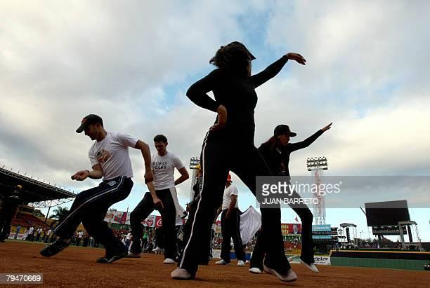 Dancers practice their moves in the Cibao stadium 01 February in Santiago de los Caballeros 150 kms from Santo Domingo Dominican Republic The...