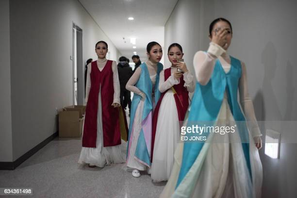 TOPSHOT Dancers prepare backstage prior to a performance marking the oneyear countdown to the 2018 Pyeongchang winter olympics at the Gangneung Ice...
