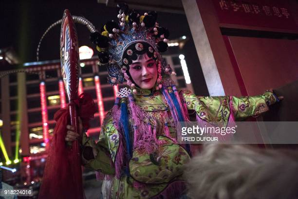 Dancers prepare to parade for the She Huo festival near Tang Paradise park in Xian Shaanxi province on February 14 ahead of the coming Lunar New Year...