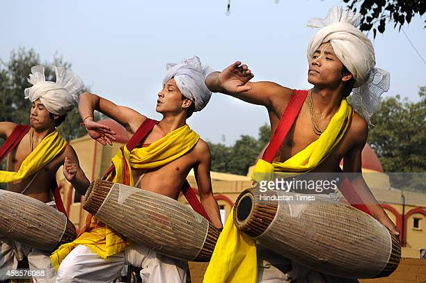 Dancers present traditional Pung cholom from Manipur at North East festival on November 7 2014 in New Delhi India In this style the dancers play the...