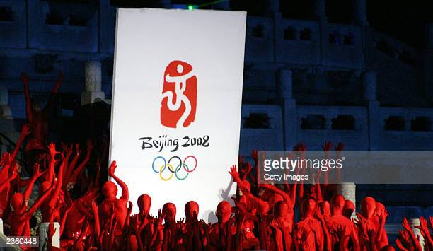 Dancers put up the official emblem for the 2008 Olympic Games August 3, 2003 at the Temple of Heaven in Beijing. The emblem stands for Beijing's...