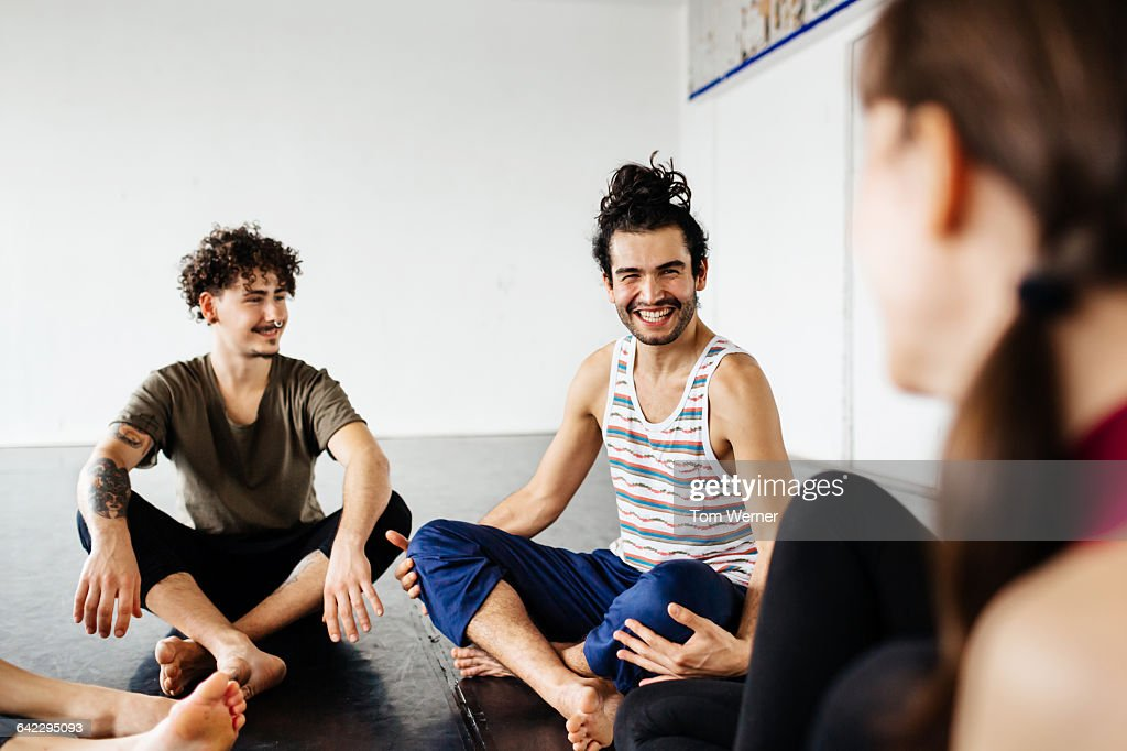 Dancers sitting in a dance studio having a break : ストックフォト
