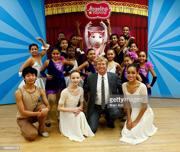 Dancers surround Nigel Lythgoe Executive Producer to 'American Idol' and 'So You Think You Can Dance' at the First Angelina Ballerina Stars of...