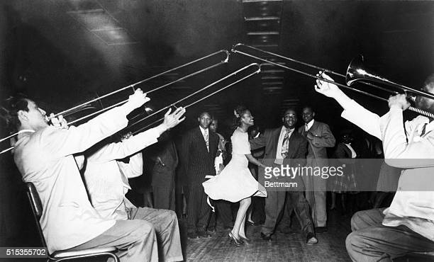 Dancers swing to the sound of trombones at the Savoy Ballroom namesake of the popular song 'Stomping at the Savoy' by Benny Goodman Chick Webb and...