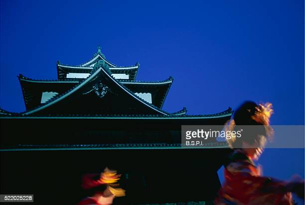 Dancers Swirling in Front of Matsue Castle During Cherry Blossom Festival