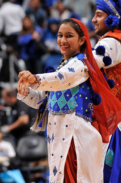 Dancers take part in a traditional Indian Bhangra dance during the game between the Detroit Pistons and the Orlando Magic on January 27 2013 at Amway.