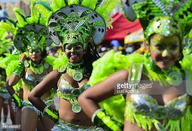 Dancers take part in the third day of carnival parade in Barranquilla Colombia on February 11 2013 Barranquilla's Carnival a tradition created by...