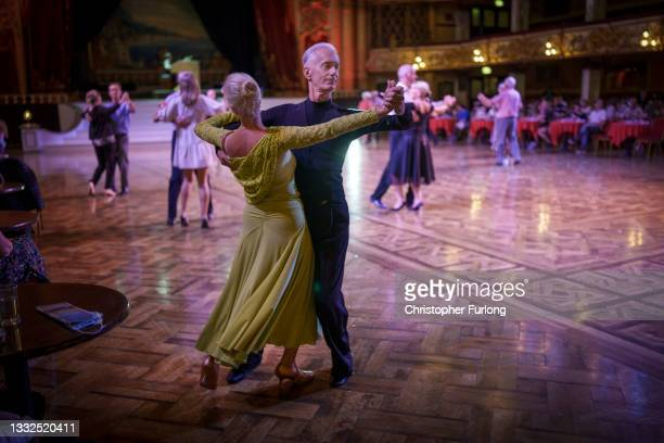 Dancers take to the famous Blackpool Tower Ballroom and move to the sound of the famous Wurlitzer organ on August 05, 2021 in Blackpool, England. The...