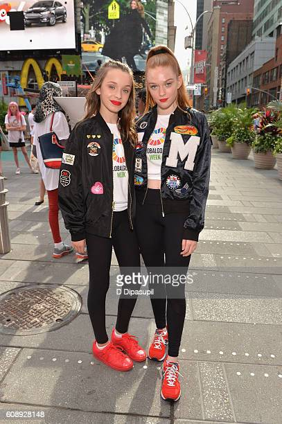 Dancers Taylor Hatala and Larsen Thompson pose near the 2016 Global Goals Girls Bus in Times Square on September 20 2016 in New York City
