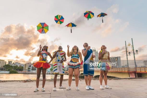 dancers throwing frevo umbrellas - frevo imagens e fotografias de stock