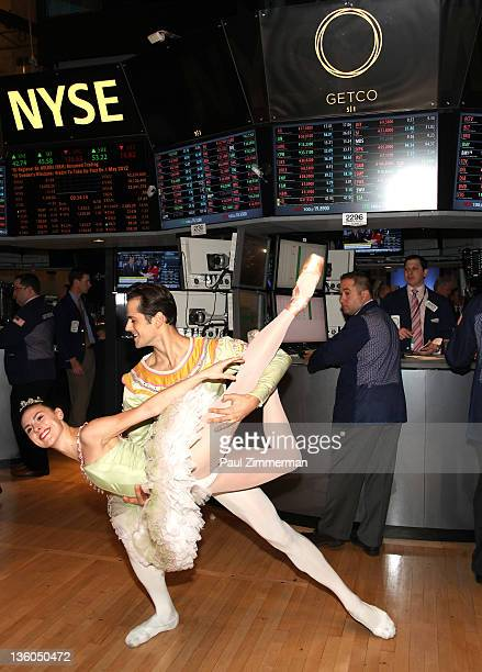 Dancers Tiler Peck and Robert Fairchild from the New York City Ballet production of 'The Nutcracker' pose for a photo after ringing the opening bell...