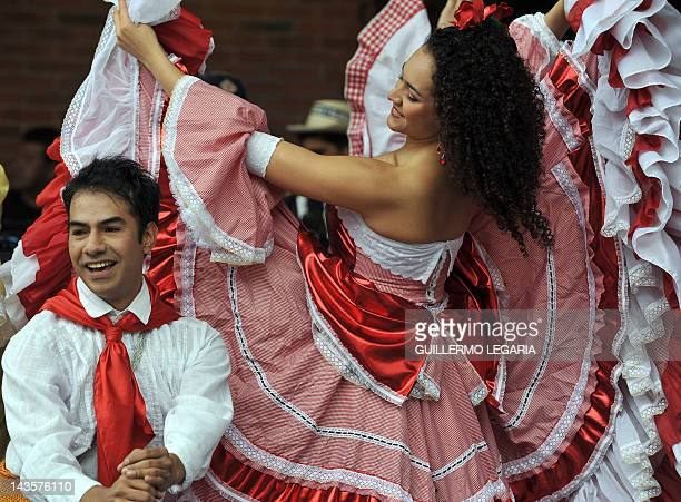 Dancers try to set a Guinness World Record for the greatest number of people dancing to the iconic song of Wilson Choperena 'La Pollera Colora'...