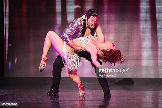 Dancers Valentin Chmerkovskiy and Sharna Burgess perform during the 'Dancing With The Stars' live tour at Paramount Theatre on December 21 2016 in...