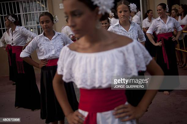 Dancers wait to perform for the Virgen del Carmen brotherhood procession during the Carmen day celebrations in Malaga southern Spain on July 16 2015...