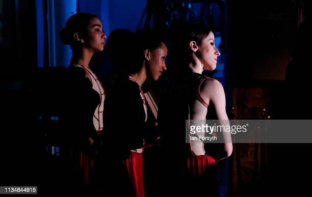 Dancers watch from the wings as they wait to enter the stage during the during the World Premier of Northern Ballet's performance of 'Victoria' at...
