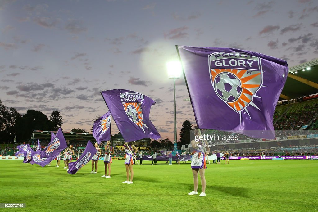 Dancers wave flags before the players walk onto the pitch during the round 21 A-League match between the Perth Glory and Melbourne City FC at nib Stadium on February 24, 2018 in Perth, Australia.