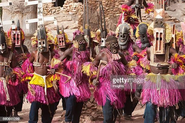 Dancers wearing Kananga mask at the Dama celebration in Tireli Mali