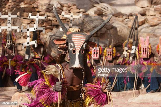 Dancers wearing Kananga masks perform at the Dama celebration in Tireli Mali