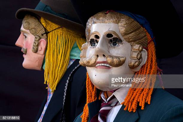 Dancers wearing masks representing the Spainish conquerors over the Maya during Zunil's annual Novem