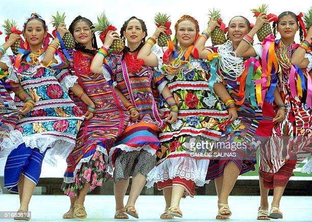 Dancers wearing traditional dresses perform the Pineapple Flower dance in Oaxaca Mexico 22 July 2002 The dance which originated in the Tuxtepec...