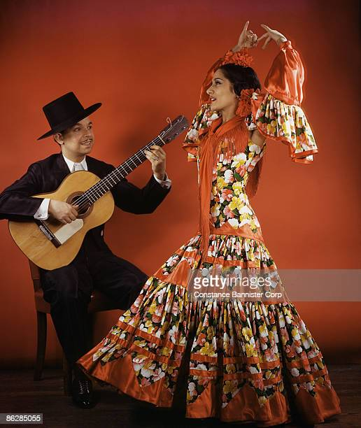 Dancers wearing traditional flamenco costume