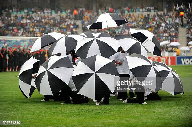 Dancers with black and white umbrellas during the opening ceremony of the Moses Mabhida Stadium in Durban South Africa one of the venues of the FIFA...