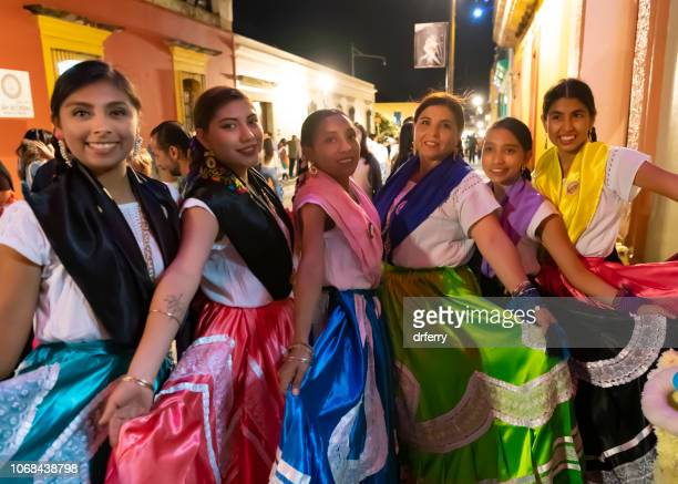 dancers with colorful skirts at the dia de los muertos festival in oaxaca - mexican fiesta stock pictures, royalty-free photos & images