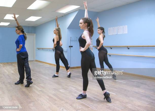 dancers with professional practise their routine in a ballet class - leotard stock photos and pictures