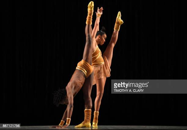 TOPSHOT Dancers with the Alvin Ailey American Dance Theater perform a scene from Twyla Tharps 'The Golden Section' during a dress rehearsal December...