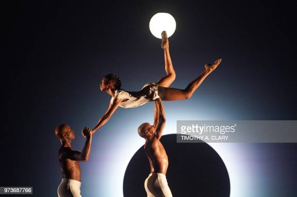 TOPSHOT Dancers with the Alvin Ailey American Dance Theater perform a scene from the World Premier of 'EN' during a dress rehearsal June 13 before...