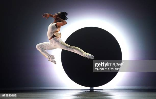 TOPSHOT Dancers with the Alvin Ailey American Dance Theater perform a scene from the World Premier of EN during a dress rehearsal June 13 before...