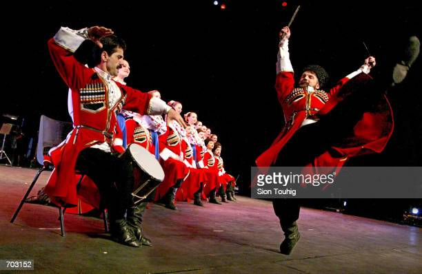 Dancers with the Russian Cossack State Song And Dance Ensemble rehearse February 27 2002 in the Peacock Theatre in London prior to their first...